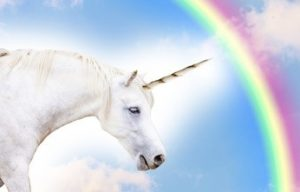 Unicorn with rainbow in the sky